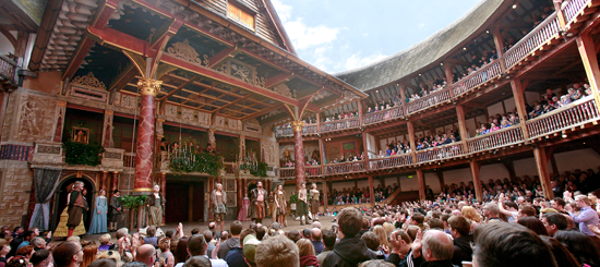 SHAKESPEARE'S GLOBE IN BANKSIDE, LONDON. LIKE THE ORIGINAL THEATER, IT IS OPEN AIR WITH STANDING AUDIENCE PIT.