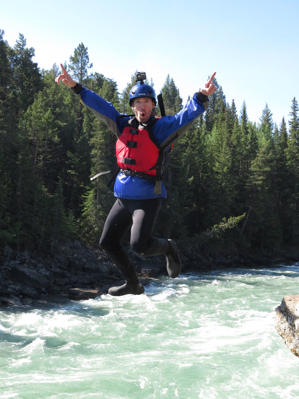 We found this super fun picture of Jon jumping off the cliff while drinking tea and having snacks! Photo: Chinook Rafting