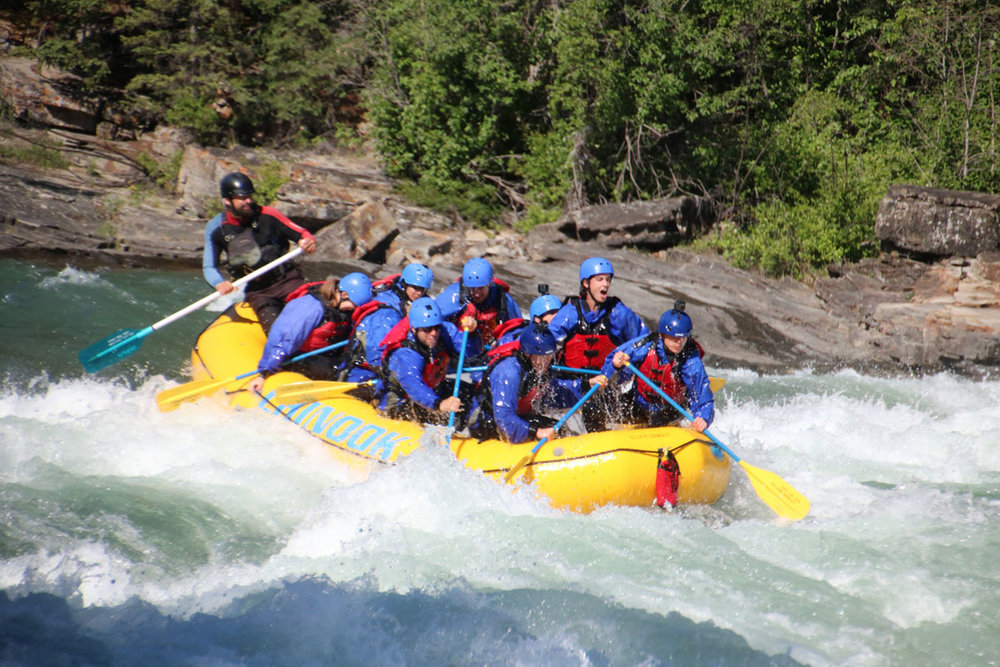 Our incredible guide Alex took us through our first class 4 rapid, which was right around the first bend! Photo: Chinook Rafting