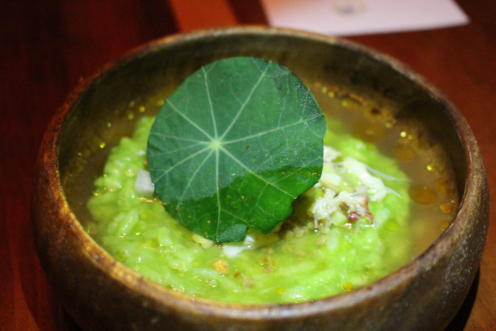Dungeness crab arroz caldo with green garlic, crab dashi and nasturtium (Photo: Tamara Palmer)