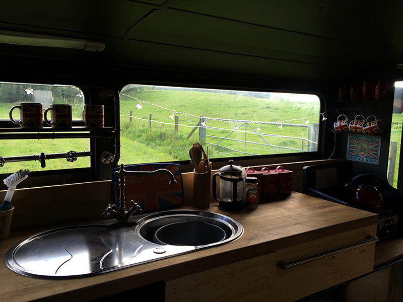 partyfield dorset party field bertie the bus kitchen view.JPG