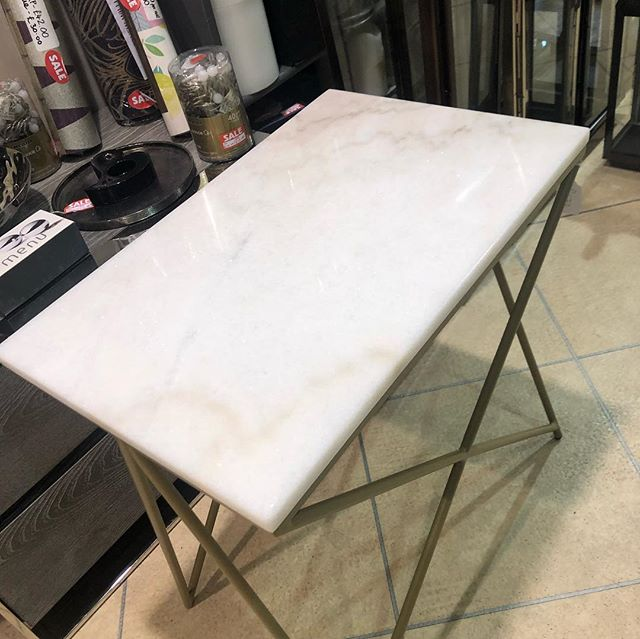 Gorgeous new side table. Solid marble top with gold legs. Very substantial piece of furniture. Would look gorgeous in any home.