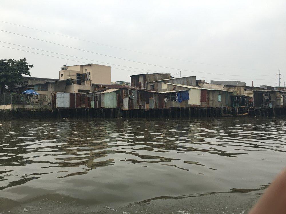 All along the riverbanks, shanty towns & hidden markets  Ho Chi Minh City, Vietnam