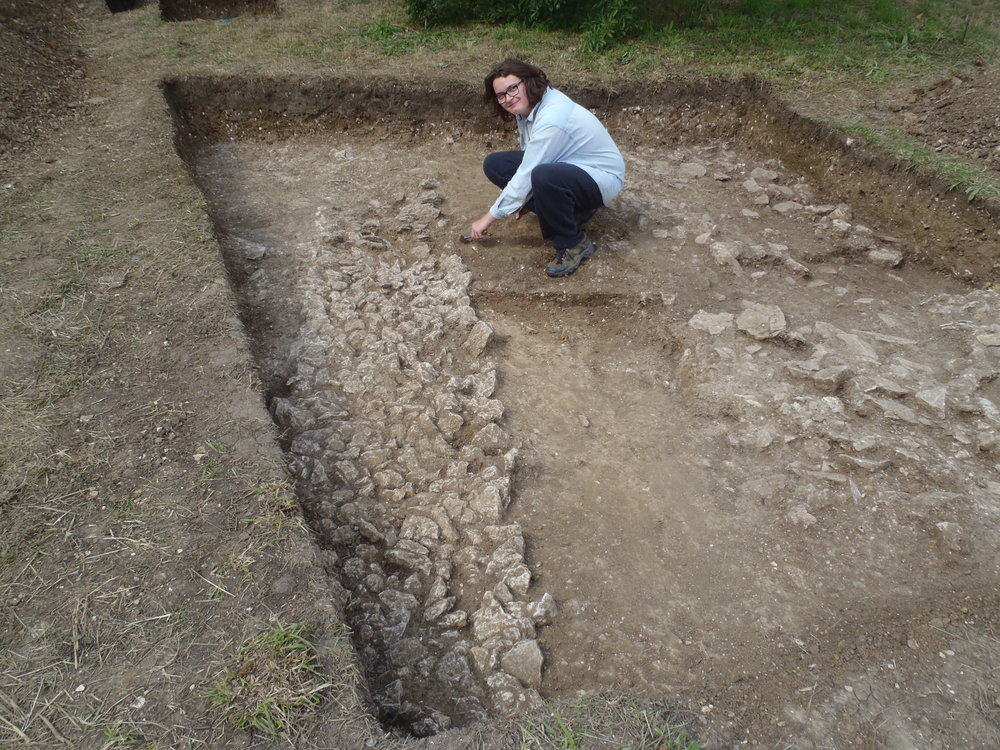Work experience student on community dig, August 2015