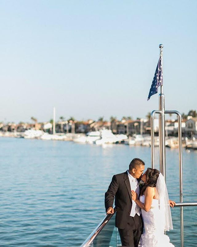 When you arrive on your wedding party yacht via a gondola ride, that's what we call swagggg! Happy happy anniversary @abcruzcross @ejcruzcross ! . . . #dorothyroseevents #newportbeach #ocweddingplanner #swag #yachtwedding #electracruises #eternityyacht #weddingplanner