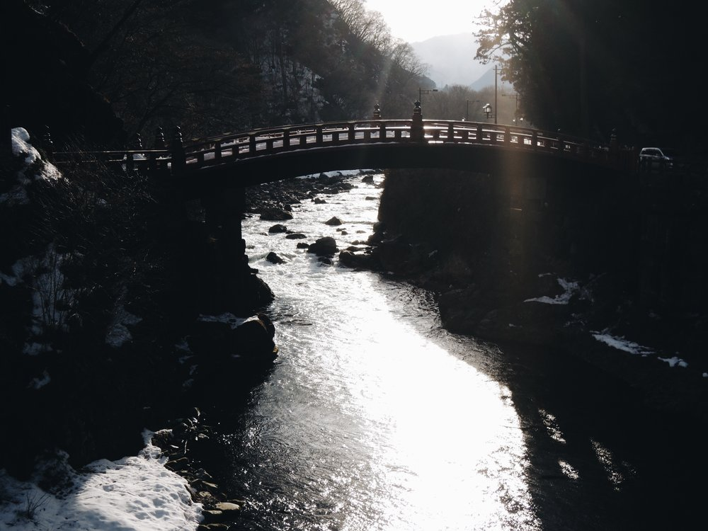 The clear waters of the Daiya River running under the Shinkyo Bridge