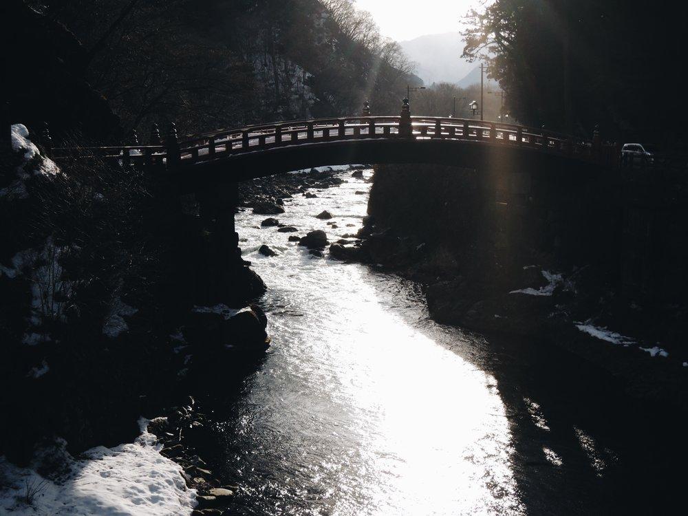 The clear waters of the Daiya River running under the Shinkyo Bridge