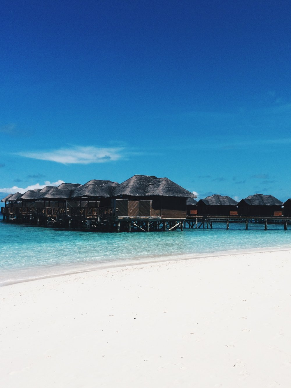 The overwater bungalows at Fihalhohi