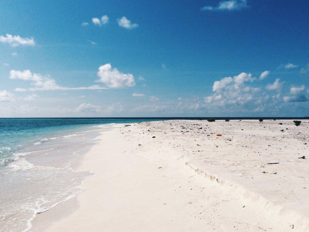An uninhabited sandbank just a short sailing trip away from our resort
