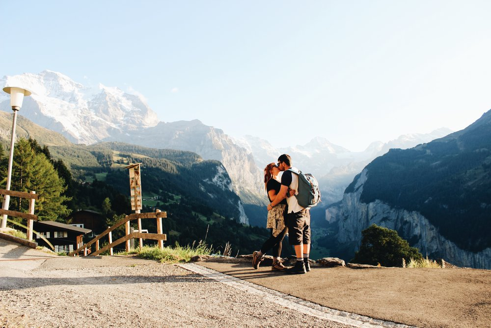 A celebratory kiss within the incredible landscape of Wengen.jpeg