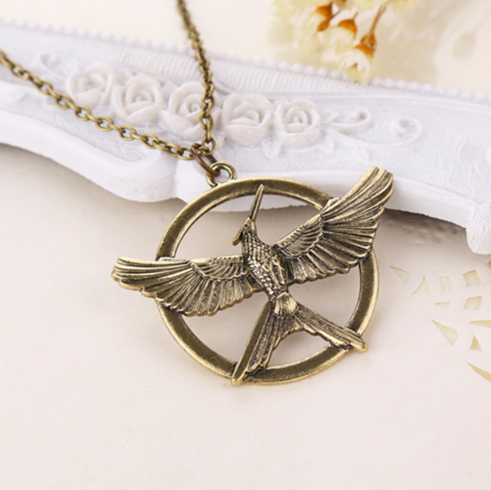 Hunger games mockingjay emblem necklace the crow emporium hunger games mockingjay charm necklace aloadofball Images