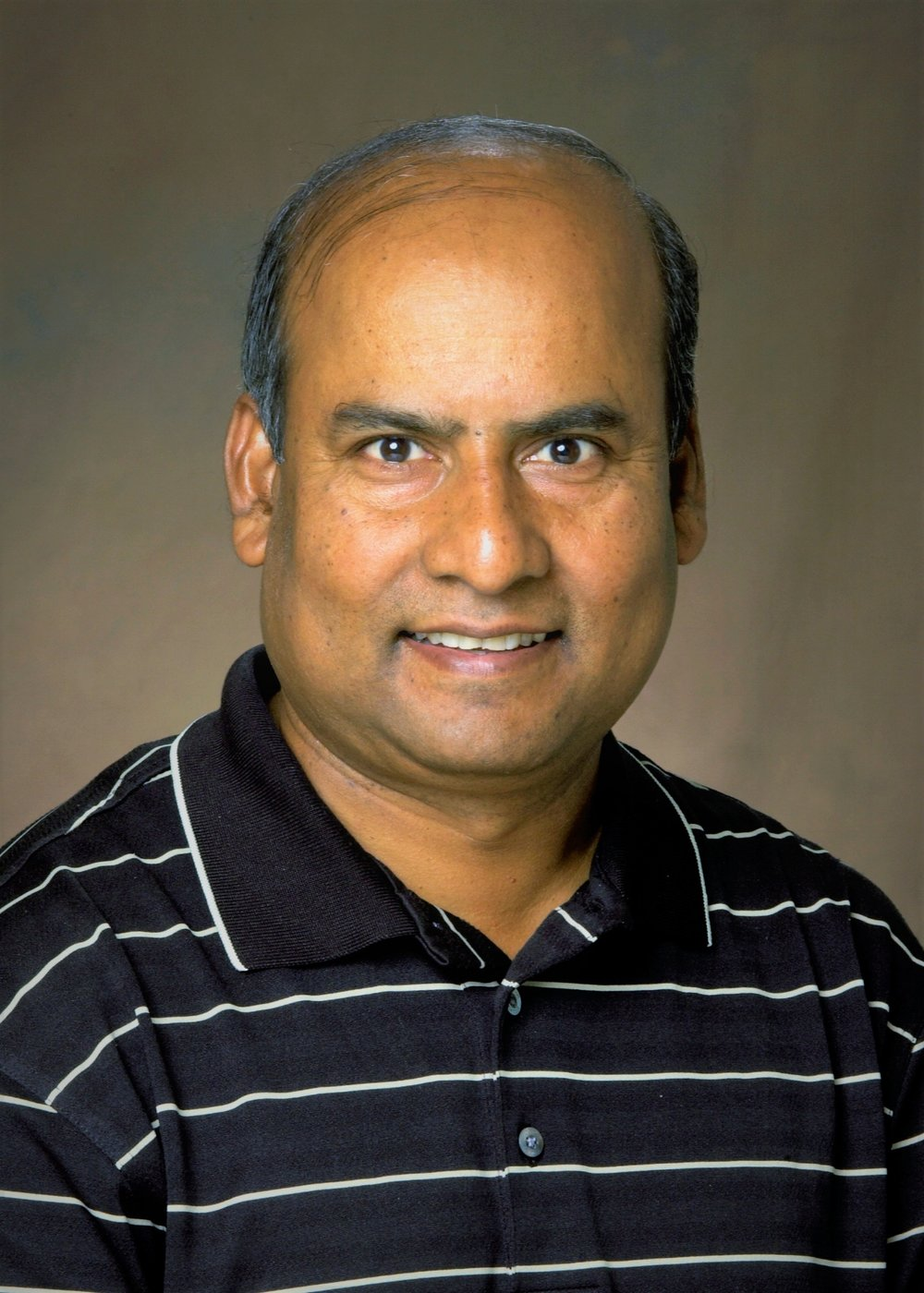 Mukhlesur Rahman - Dr. Mukhlesur Rahman is an Assistant Professor at the Department of Plant Sciences, North Dakota State University (NDSU), Fargo USA. He has been working as canola breeder and geneticists in the department since 2008. Recently, he has taken the responsibility of NDSU flax breeding program from July 2017. Dr. Rahman has received his Ph.D. degree in plant breeding and genomics from the University of Manitoba, Canada in 2007. He received his M.S. degree in biotechnology from Tokyo University of Agriculture and Technology in 2003, and M.Sc.Ag. degree in genetics and plant breeding from Bangladesh Agricultural University in 1995. He served as a faculty member (Assistant Professor) in the Department of Genetics and Plant Breeding of Bangladesh Agricultural University from 1996 to 2007. He also served as Scientific Officer (Oilseed breeding) at Bangladesh Agricultural Research Institute from 1993 to 1996. Dr. Rahman's expertise is in the area of plant breeding, genetics study, and genomics analysis for oilseed crops especially rapeseed/canola and flax. He has been utilizing double haploid and molecular marker technology in the breeding program. Dr. Rahman has received a licensing agreement with INRA, France for Ogura-INRA-CMS and restorer system to utilize in canola hybrid breeding program. He has established a joint-hybrid research program with Monsanto and DL Seeds Inc. He also established an off-season (winter) breeding nursery in Chile to expedite the breeding cycle. Dr. Rahman has released two canola cultivars (roundup ready and conventional) and one flax cultivar in North Dakota from his program.