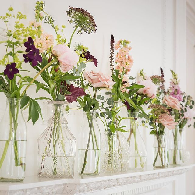 I love dressing a mantelpiece. Here I've used a selection of glass bottles and decanters to give a gorgeous subtle romantic feel. These photo was from a gorgeous summer wedding last year at @barley_wood