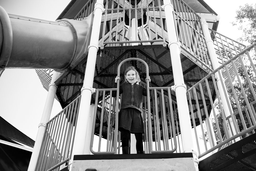 This is a fun black and white photo of a girl on playground equipment in San Dimas, CA by Erica Faith Photography.