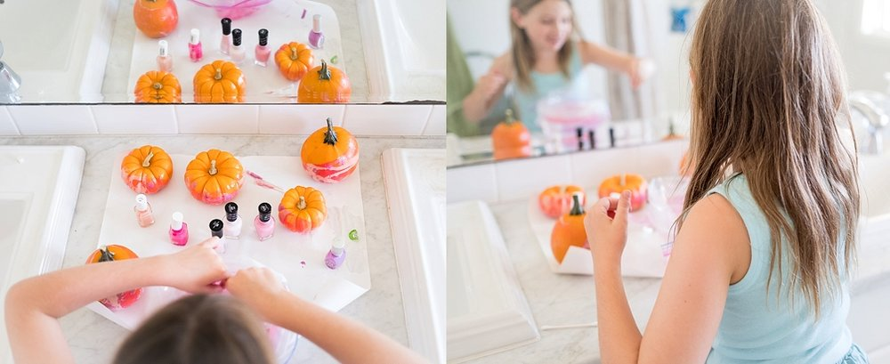 Pretty lifestyle photo of girl painting a pumpkin by Erica Faith Photography in Claremont, CA