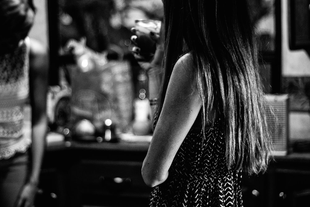 Black and white faceless portrait of women at a party.