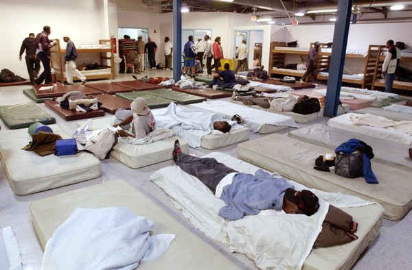 Men of the Lakeside Avenue homeless shelter in Cleveland are assigned sleeping bunks and mats in this 2002 file photo. The rights of the homeless in Ohio to stay on the voting rolls even without a fixed address, other than, sometimes, an intersection, are an issue in the Ohio voter-culling case to be argued at the U.S. Supreme Court today.(Roadell Hickman, The Plain Dealer, File, 2002)