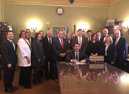Executive Director Brad Boycks and Immediate Past President David Belman attended bill signing.