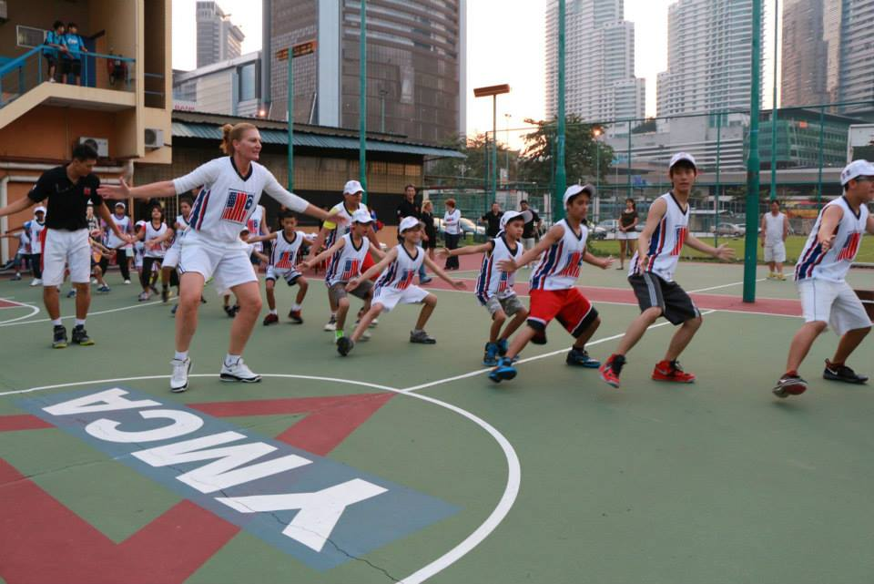 Sports Envoy and former WNBA player, Sue Wicks, leads defensive drills for youth in Malaysia.  2013.