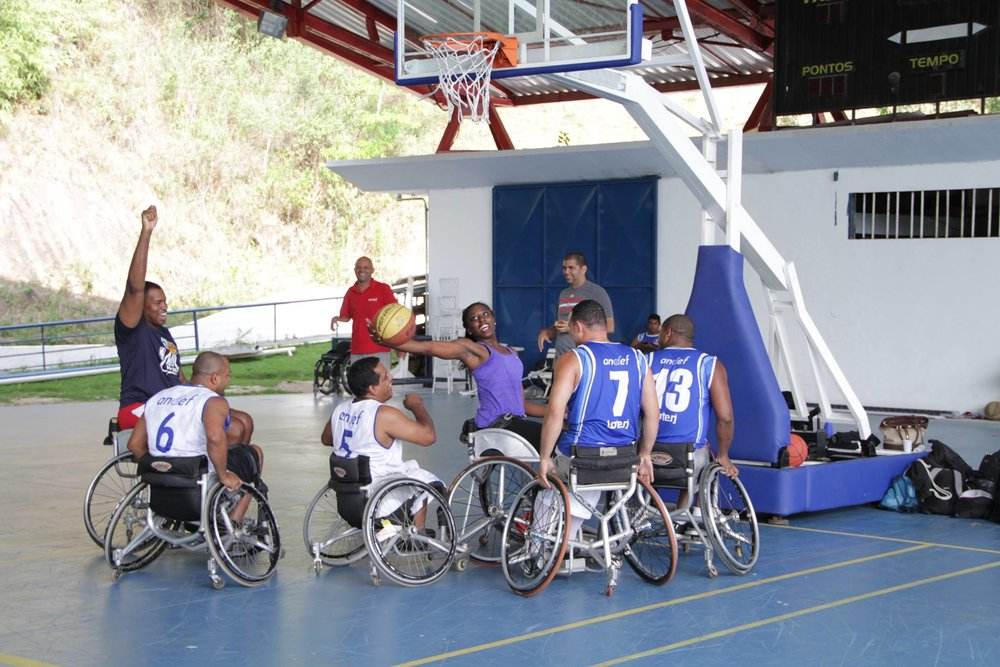 Sports Envoys Jason Collins and Chiney Ogwumike share a game with wheelchair basketball players in Brasil.  2015.