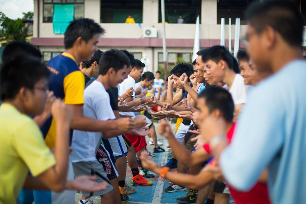 Youth in the Philippines face-off during a sports clinic lead by Global Sports Mentoring Program alum Geraldine Bernardo.   Photo courtesy of Center for Sport, Peace, and Society at the University of Tennessee.  2014.