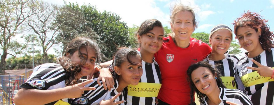 Sports Envoy and U.S. Women's National Team member, Tracy Noonan, engages with youth after a soccer clinic in Costa Rica.  2013.