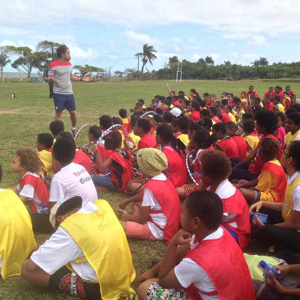 Sports Envoy and former U.S. Men's National Team member Cobi Jones engages with youth in Fiji.  2015.