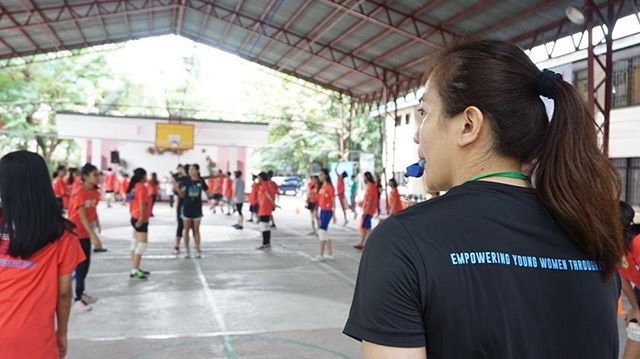 Sports Envoy Michelle Goodall leads volleyball clinics in the Philippines.  Photo courtesy of Center for Sport, Peace, and Society at the University of Tennessee.  2015.