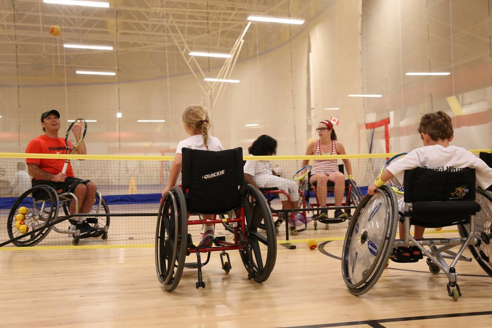 Sports Envoy and U.S. Paralympic Team member, David Wagner, leads wheelchair tennis drills with youth in Canada.  2015.