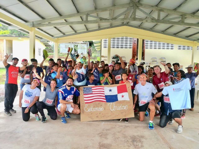 "Barry teams up with local Peace Corps volunteers to host 40+ youth from the community for an exciting 3k run, followed by the distribution of running shoes. All to show that ""Estamos Unidos""."