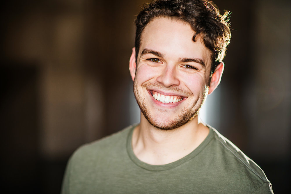 SAM WOODS    (u/s Princeton, Nicky )  is thrilled to be making his Chicago theater debut with Mercury Theater Chicago! Some of his favorite regional credits include: Ali Hakim in  Oklahoma!  (Crane River Theatre Co.); Warner in  Legally Blonde: The Musical  (Paul Bunyan Playhouse); Mercutio in an immersive re-telling of Shakespeare's  Romeo and Juliet  and Jamie Wyeth in  Nureyev's Eyes , both with the Bluebarn Theater. When not performing theatre, Sam is likely to be somewhere writing his next play or doing some kind of improvisation or sketch projects. More at  sam-woods.com .