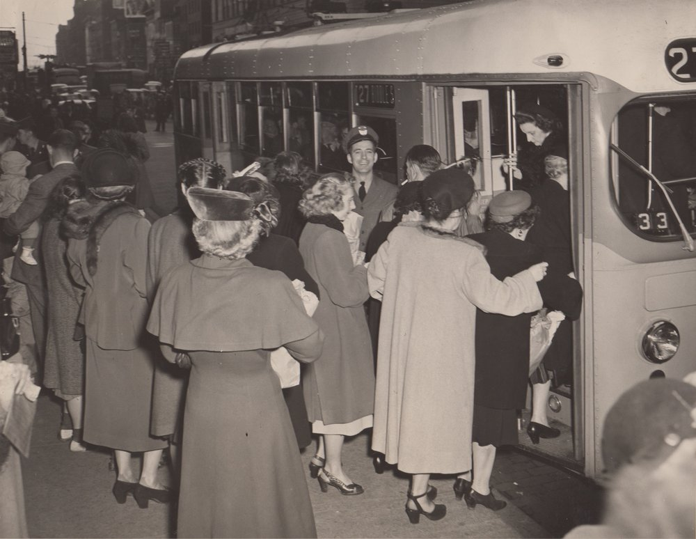Boarding a trackless trolley in the late 1940s. Image Credit: BSM Archives