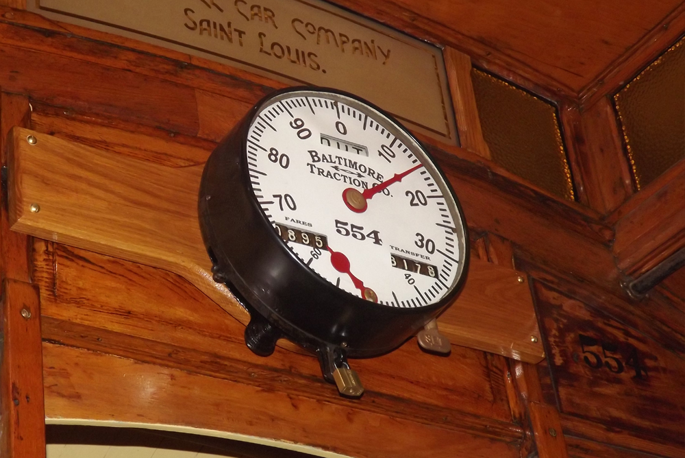 25. A real find was an original fare clock of the correct vintage. Here, with its newly designed and fabricated face plate, the clock is shown installed above the end windows.