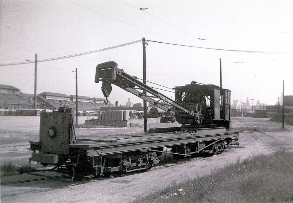 Crane 3715, Ca. 1913 Image Credit: Maryland Rail Heritage Library  Virtually every street railway system had its fleet of work cars— custom-built vehicles or homemade adaptations of former passenger cars. They performed a litany of unglamorous yet essential tasks, including grinding, placing and removing rail; servicing overhead wires; clearing snow; weeding the right of way; and cleaning streets. One of the only two pieces of Baltimore work equiptment to be preserved (overhead line truck No. 501 is the other), No. 3715is an electric crane car. The crane portion was built by Brownhoist and the carbody by the United. No. 3715 was used for a variety of tasks, including track placement and extraction, and the setting of line poles. Lifting capacity was five tons. The crane was upgraded by its new owners, Baltimore Transit, in 1938. After its withdrawal from service in the mid 1950s, the crane was purchase in 1956 by the Branford Trolley Museum in Branford, Connecticut, where it performed many of the same activities while on duty in Baltimore. In 1998, it was acquired by the BSM, bringing it back home after more than 40 years.