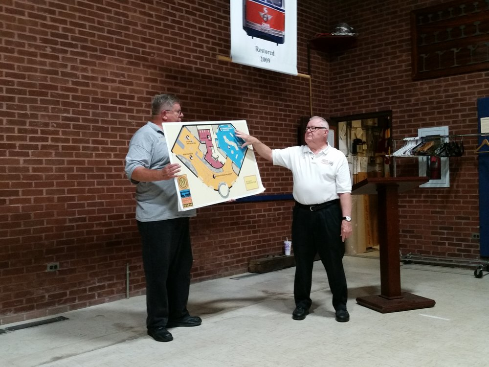 L to R BSM President John O'Neill and volunteer present the plans for the new BSM displays. Image Credit: Andy Blumberg