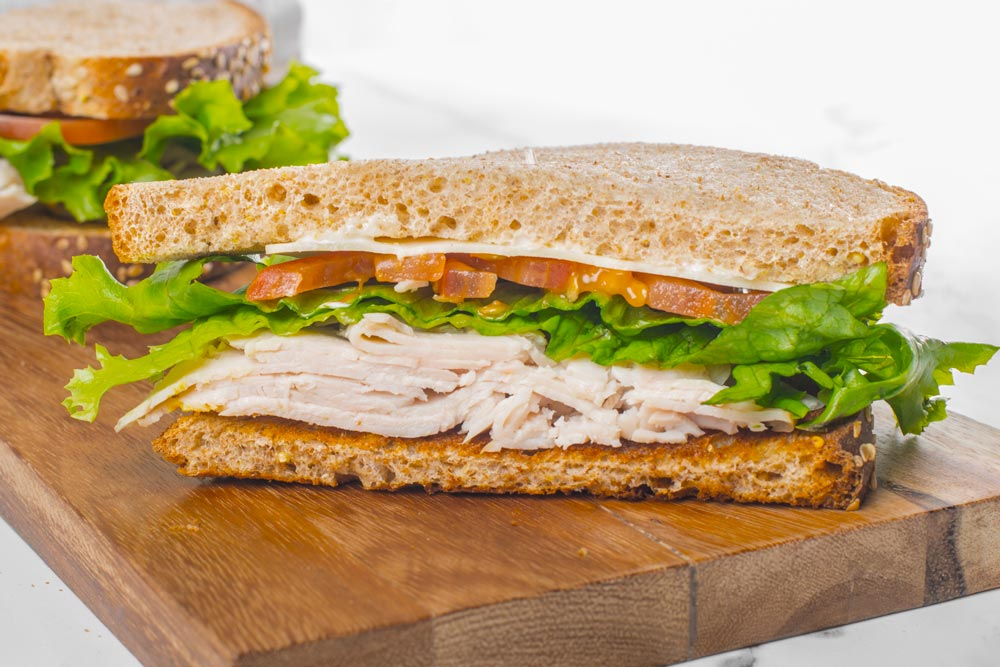Smoked Turkey & Cheese, served with your choice of bread.  White, wheat, rye, sourdough, or pita