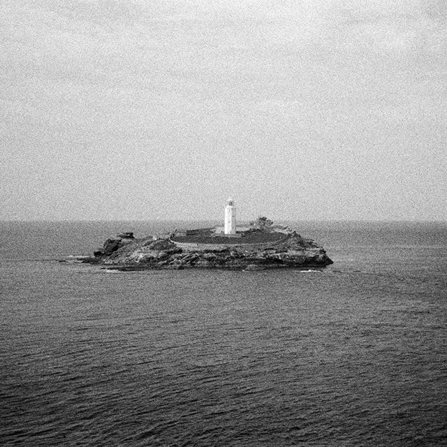Back there again. Edge of the Bay.  #bw #blackandwhite #35mm #film #photography #konica #af3 #ilfordfp4 #noise #grain #analogue #analog #godrevy #hayle #hellsmouth #coast #sea #light #virginiawoolf #lighthouse #horizon #stives #westpenwith #cornwall #home