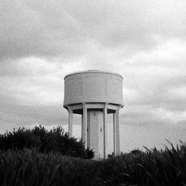 Closed.  #bw #blackandwhite #35mm #film #photography #konica#af3 #ilfordfp4 #nature #watertower #pastoral #farmland#water #structure #architecture #abandonedplaces#abandoned #ostentatious #neoclassical#wildernessculture #wilderness #moody #overcast#contrast #storm #exploring #filmgrain #noise #adventure