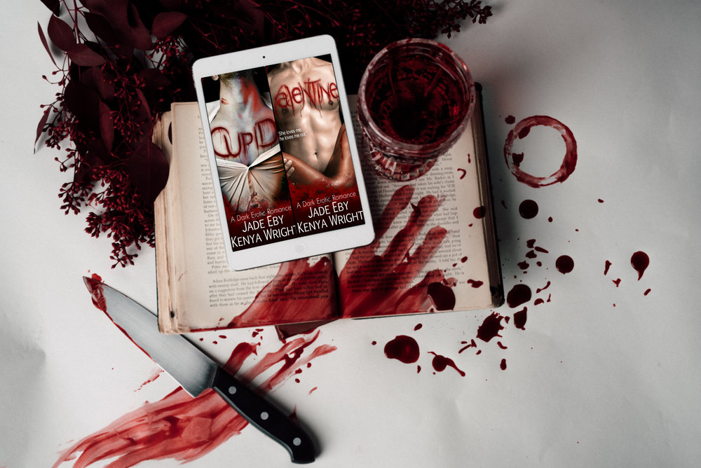 bloody book and knife and ipad.jpg