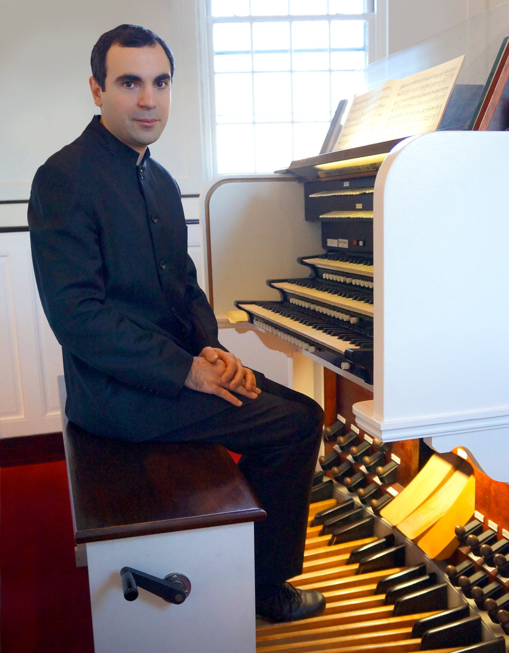 Music Director and Organist Sandro Russo at the Austin organ in 2016