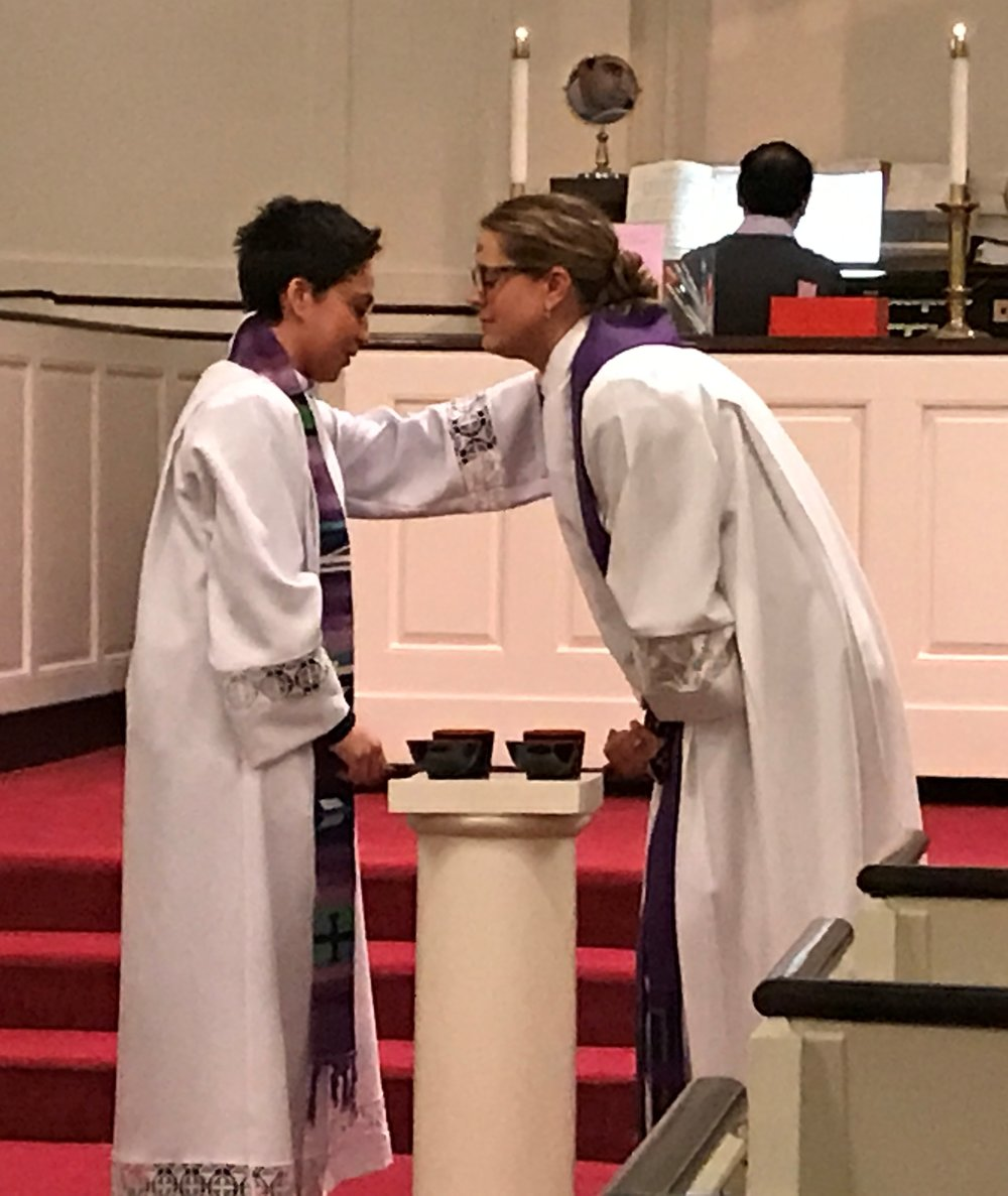Rev. Kelly Hough Rogers and Rev. Joya Colon-Berezin reciving ashes on Ash Wednesday.