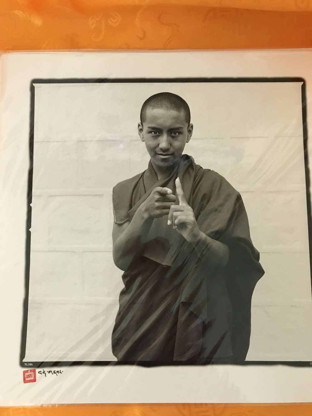 1 young monk with fingers pointing up and out #61.jpg