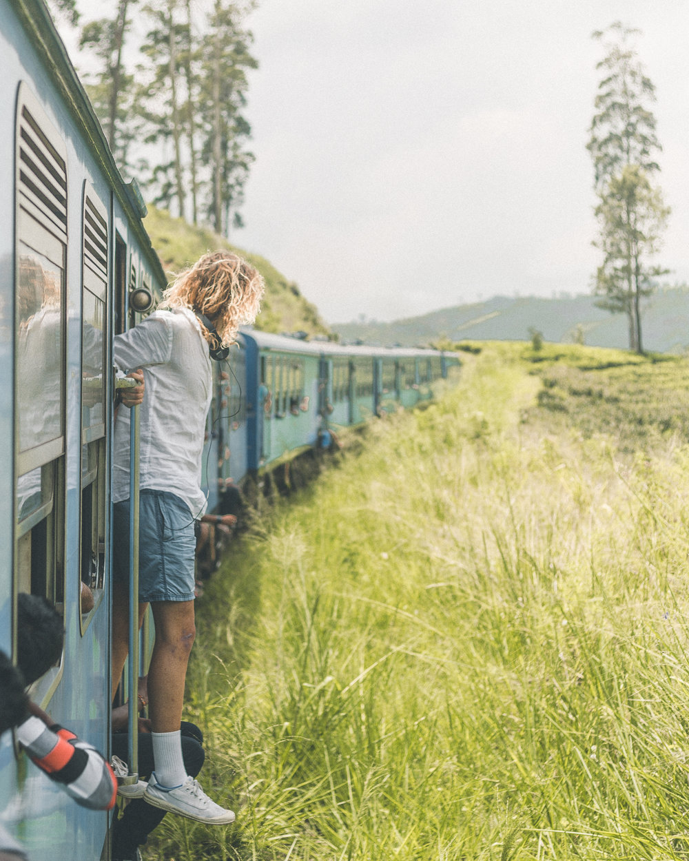 Probably the most common photo taken in Sri Lanka..How beautiful is the train and the scenery though!