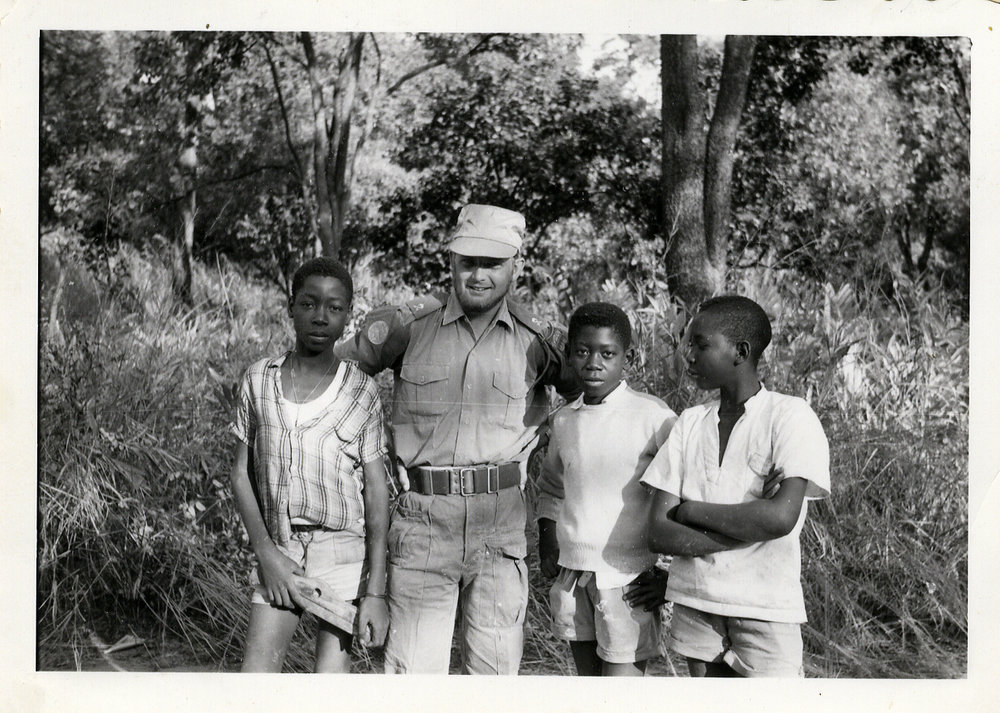 """Posing, funny!"" Frost and some children in 1961. Battalion XII."