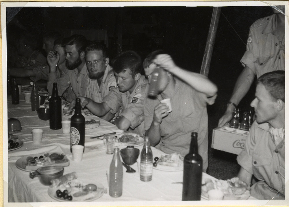 """E-ville. New Year party at the Base."" (Elisabethville). Lars Frost looks at the camera. Battalion XIV."