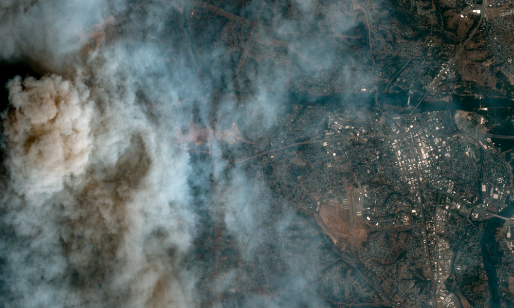 The Carr Fire burns over Redding, CA. Image courtesy of Planet Labs, 7/26/18 18:26 UTC.