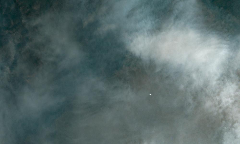 A plane flies through smoke from the Ferguson Fire near Yosemite National Park. Image courtesy of Planet Labs, 7/27/18 18:14 UTC.