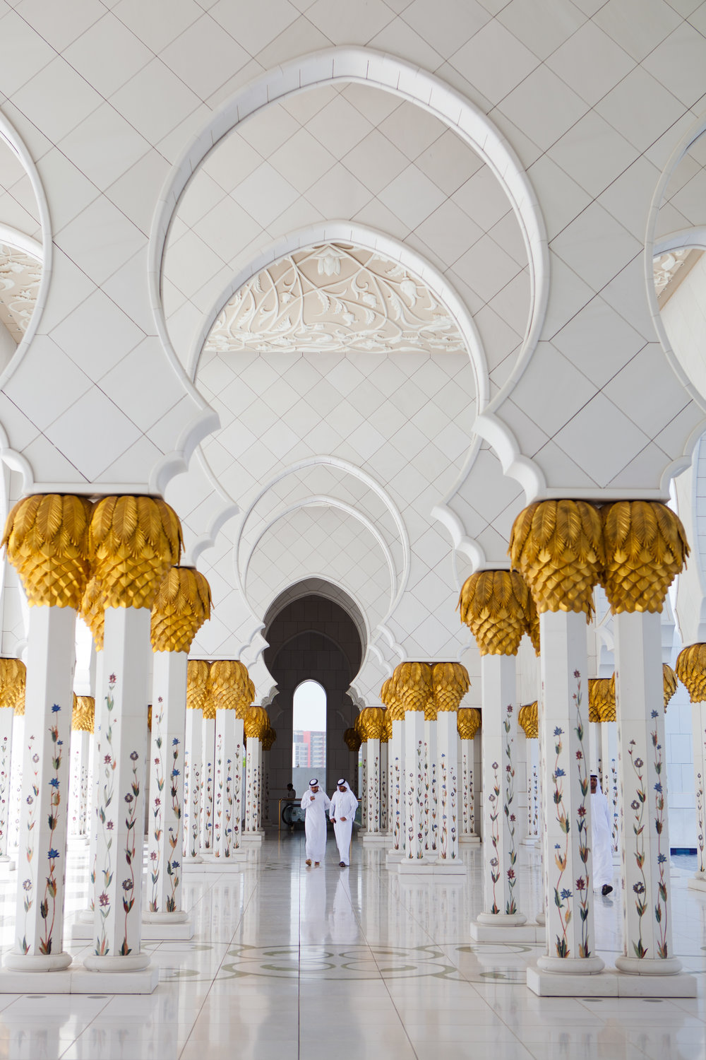 Had I not looked behind me while shooting the main portion of the Sheikh Zayed Grand Mosque in Abu Dhabi, I would have missed this moment between two local men.