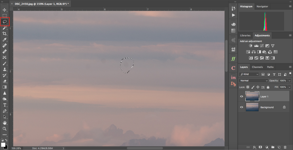 Copy your layer (Cmd+J) and circle one of the dust spots