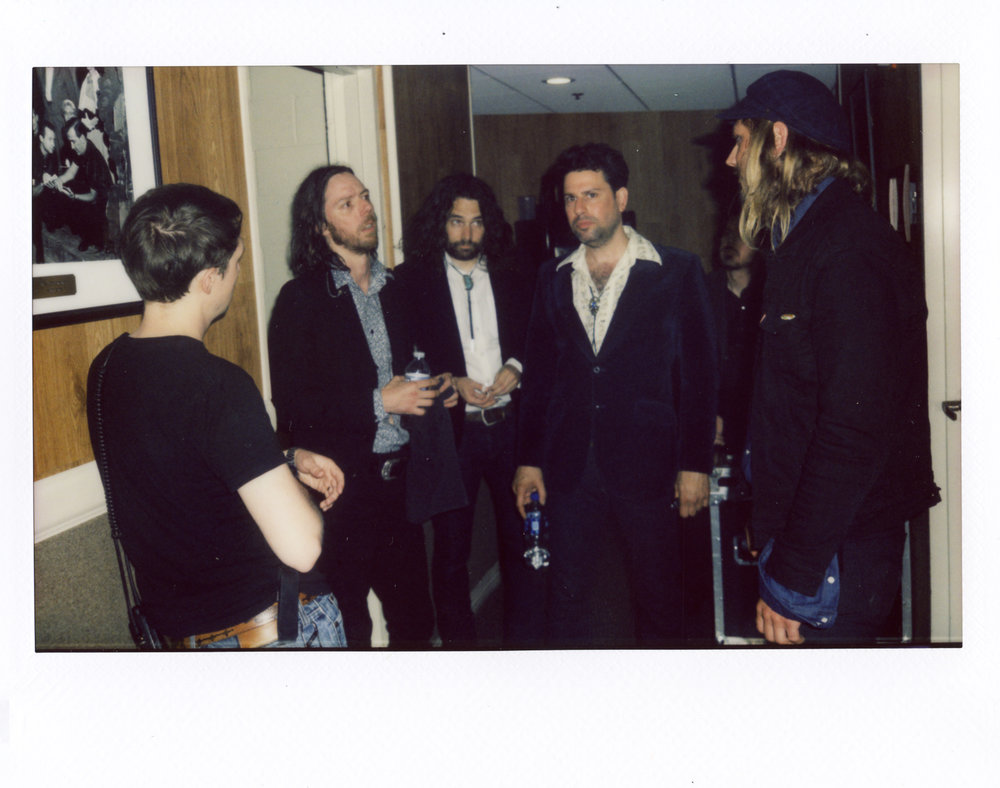 Tour manager Mike O'Neil talking with the guys side stage